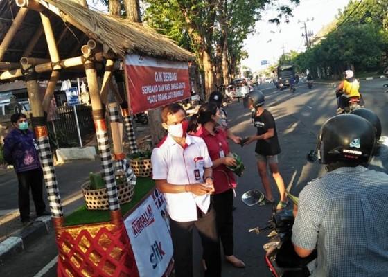 Nusabali.com - ojk-berbagi-nasi-jinggo-di-denpasar