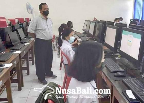 Nusabali.com - terkendala-server-simulasi-asesmen-nasional-sma-krodit