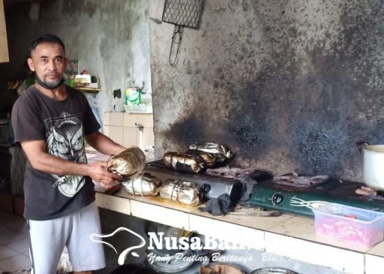 Nusabali.com - pandemi-omzet-pedagang-betutu-turun