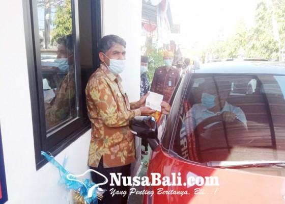 Nusabali.com - imigrasi-singaraja-luncurkan-layanan-pasport-drive-thru