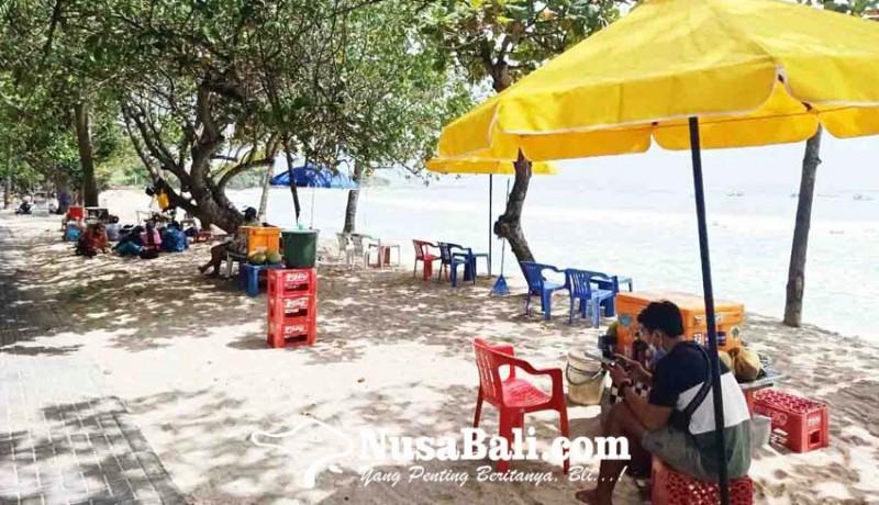 www.nusabali.com-200-pedagang-di-pantai-kuta-mulai-berjualan
