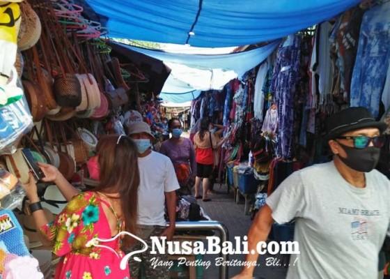 Nusabali.com - pedagang-pernak-pernik-pantai-sanur-sudah-bisa-tersenyum