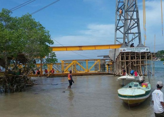 Nusabali.com - jembatan-kuning-ditarget-selesai-22-januari