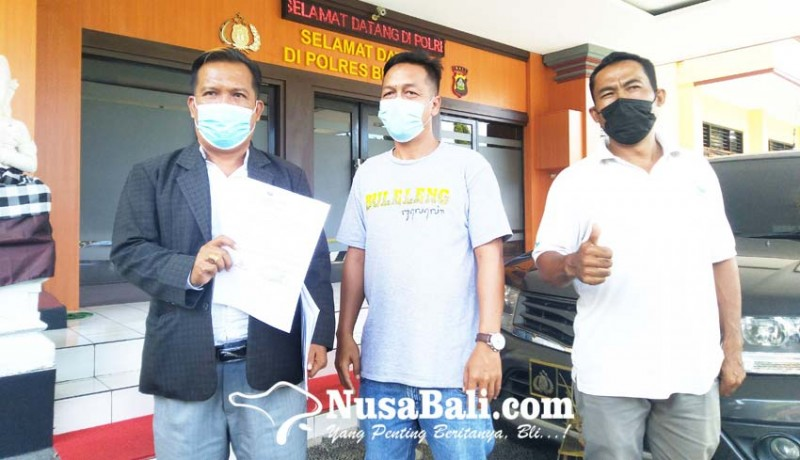 www.nusabali.com-relawan-cawi-lapor-polisi