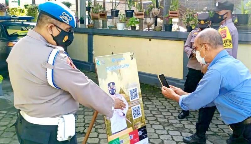 www.nusabali.com-polisi-bantu-sosialisasikan-pedulilindungi