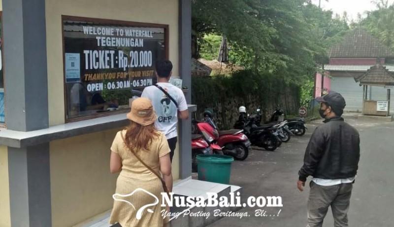 www.nusabali.com-wisatawan-air-terjun-tegenungan-wajib-scan-qr-peduli-lindungi