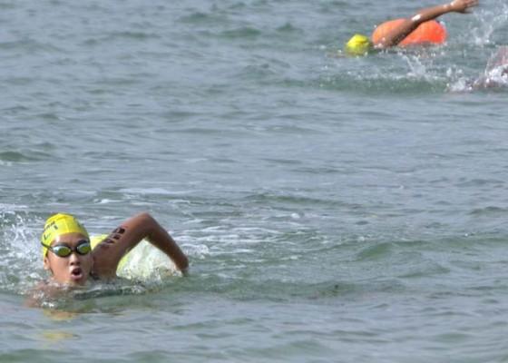 Nusabali.com - 161-perenang-meriahkan-oceanman-bali-2021-di-pantai-mertasari-sanur