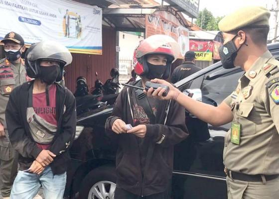 Nusabali.com - tim-yustisi-denpasar-kembali-jaring-32-pelanggar-prokes