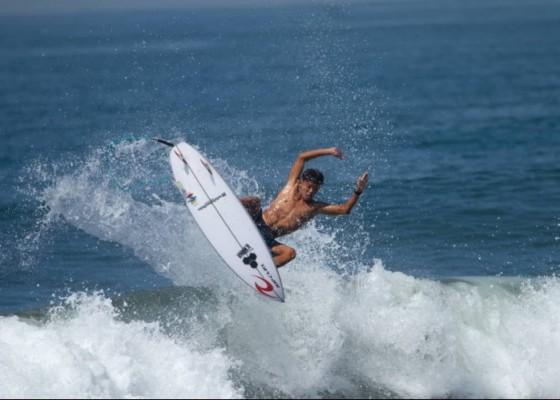 Nusabali.com - ryuki-waida-wins-two-golds-in-surfing-for-bali-pon-xx-papua
