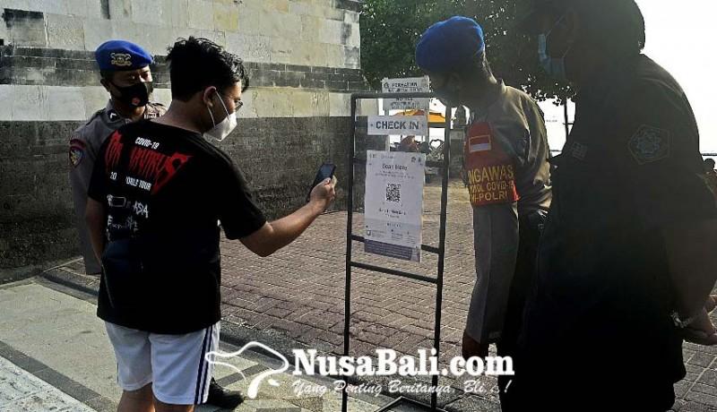www.nusabali.com-pengunjung-pantai-kuta-dibatasi