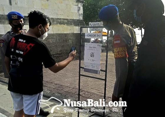 Nusabali.com - pengunjung-pantai-kuta-dibatasi