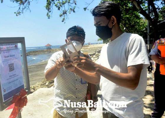 Nusabali.com - masuk-pantai-di-sanur-harus-pakai-aplikasi-pedulilindungi