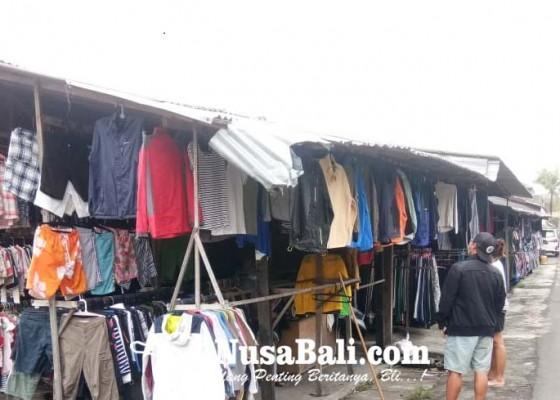 Nusabali.com - level-ppkm-sudah-turun-pasar-kodok-masih-sepi-pembeli