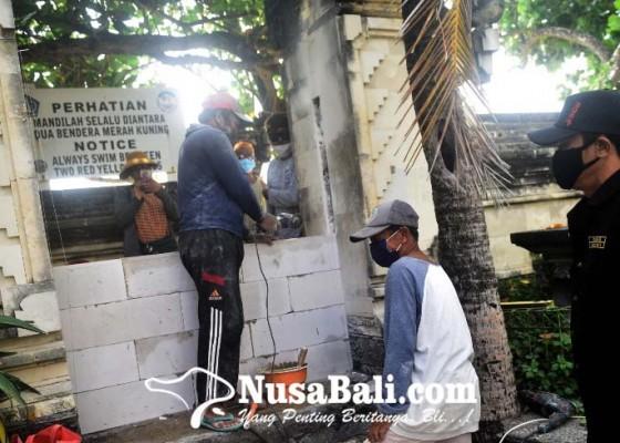 Nusabali.com - desa-adat-tutup-17-akses-masuk-pantai-kuta
