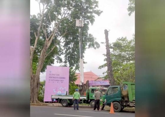 Nusabali.com - masuki-musim-penghujan-dinas-lhk-giatkan-perompesan-pohon