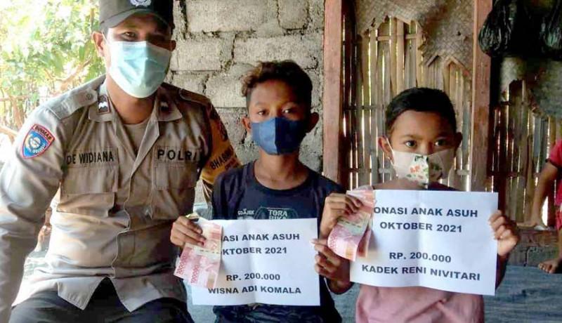 www.nusabali.com-polsek-kubu-salurkan-bantuan-bekal-sekolah