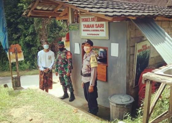 Nusabali.com - bhabinkamtibmas-dan-babinsa-tinjau-prokes-di-objek-wisata-air-terjun-tamansari