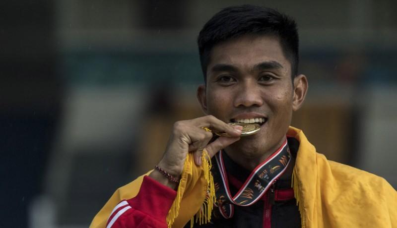 www.nusabali.com-medali-emas-ketut-merta-yasa-tak-terkejar-di-atletik