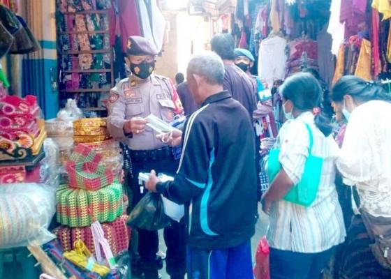 Nusabali.com - razia-prokes-polsek-pupuan-sasar-terminal-dan-pasar