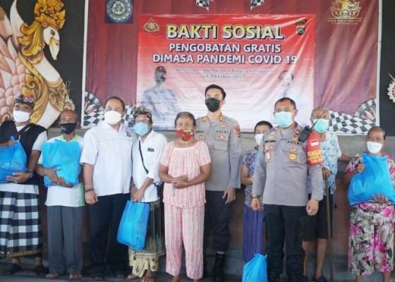 Nusabali.com - polres-gandeng-dr-caput-baksos-pengobatan-gratis