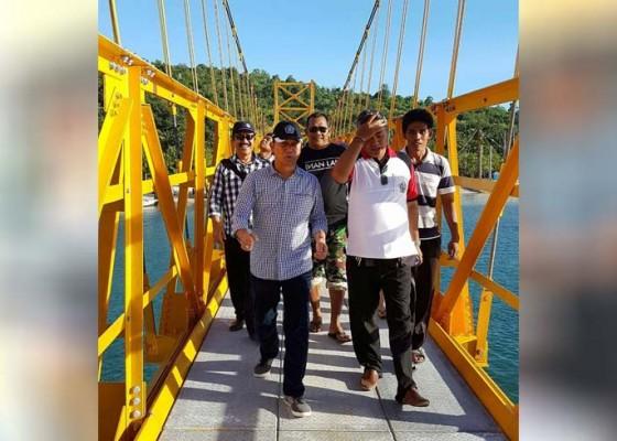 Nusabali.com - jembatan-kuning-dipelaspas