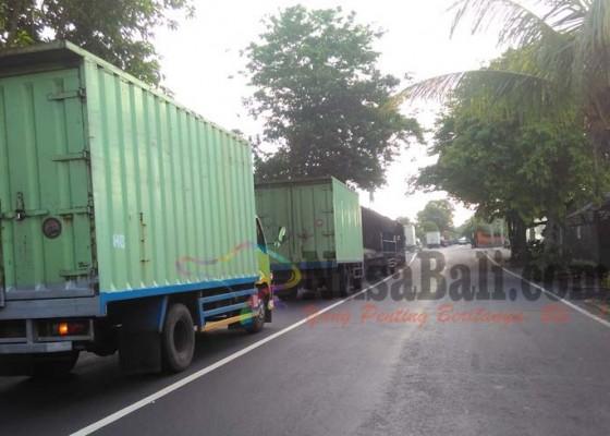 Nusabali.com - kendaraan-truk-mulai-padati-arus-mudik