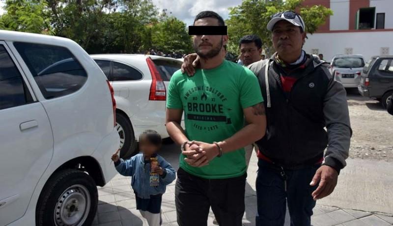 www.nusabali.com-rampas-taksi-pria-bertato-logo-ormas-ditangkap