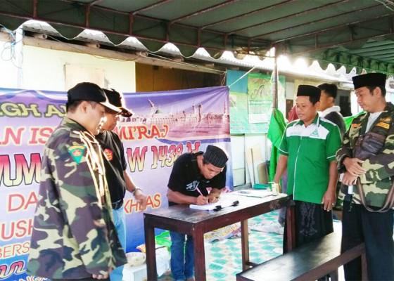 Nusabali.com - gp-ansor-dan-fpmb-beri-santunan-korban-kebakaran