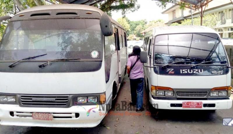 www.nusabali.com-dua-bus-dinas-rusak-satu-bus-akinya-hilang