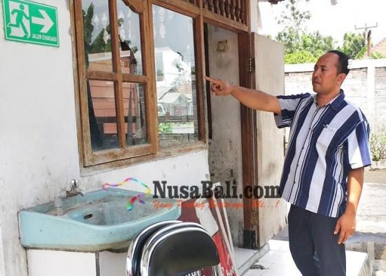 Nusabali.com - lawan-perampok-satpam-luka-luka