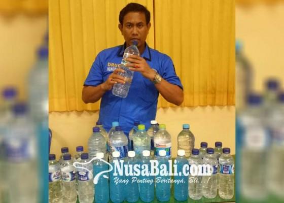 Nusabali.com - operasi-miras-puluhan-liter-arak-diamankan