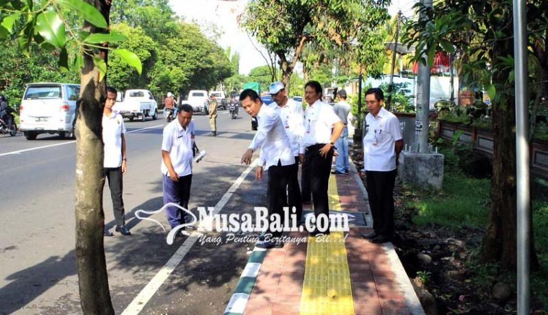 www.nusabali.com-bahu-jalan-kota-negara-ditanami-tangi