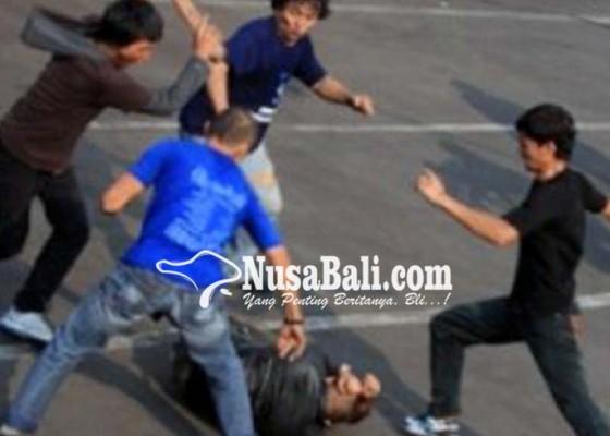 Nusabali.com - dikeroyok-penghuni-kos-babak-belur