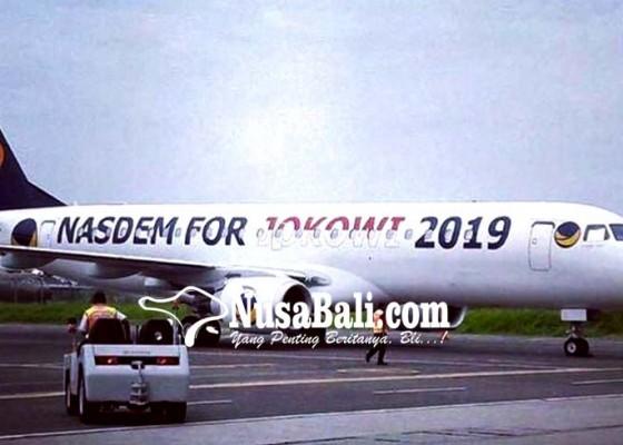 Nusabali.com - nasdem-for-jokowi-2019-di-badan-pesawat-surya-paloh