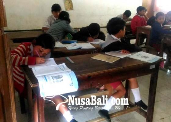 Nusabali.com - pulang-lebih-awal-kalau-terjadi-hujan-lebat