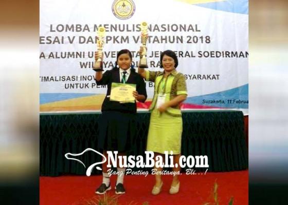 Nusabali.com - kepala-smpn-2-manggis-juara-pembina-lkti-nasional