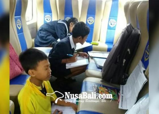 Nusabali.com - bus-sekolah-juga-untuk-kerjakan-tugas