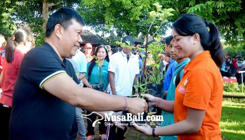 www.nusabali.com-pemkot-tanam-500-bibit-pohon-di-subak-sembung