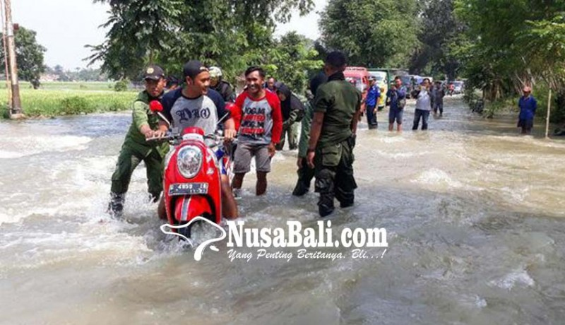 www.nusabali.com-sungai-meluap-jalur-brebes-jatibarang-terendam