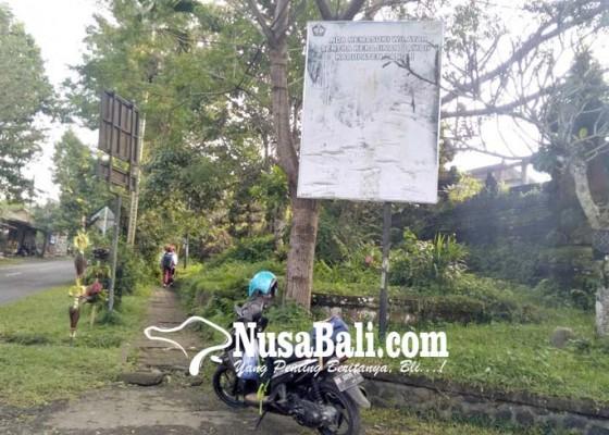 Nusabali.com - lapuk-papan-reklame-tak-kunjung-diperbaiki