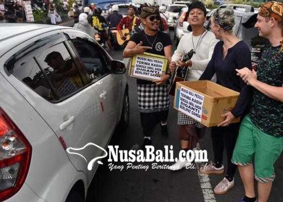 Nusabali.com - musisi-bali-ngamen-massal-untuk-susik-bondres