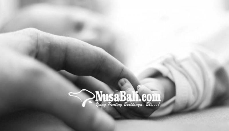 www.nusabali.com-bayi-dalam-botol-di-rumah-kosong