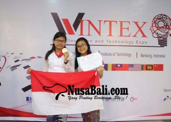 Nusabali.com - dua-siswi-smpn-3-denpasar-raih-perak-di-ajang-internasional-wintex