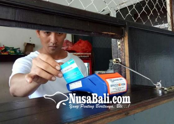 Nusabali.com - napi-lp-tabanan-belanja-pakai-e-money