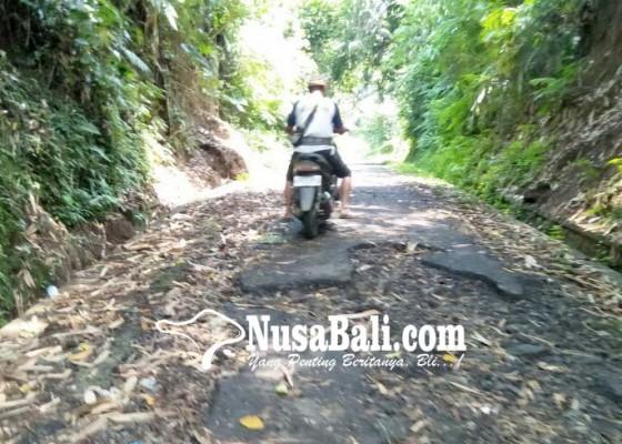 Nusabali.com - perbaikan-jalan-rusak-ditunda