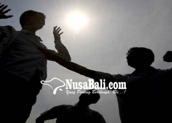 Nusabali.com - keroyok-polisi-tiga-oknum-pecalang-disidang