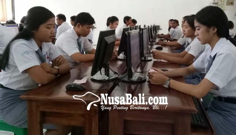 www.nusabali.com-unbk-sman-1-kediri-mundur-15-menit-karena-token-dari-pusat-telat-muncul