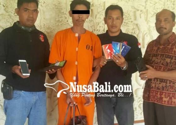 Nusabali.com - tergoda-saat-melihat-tas-menggantung-di-motor