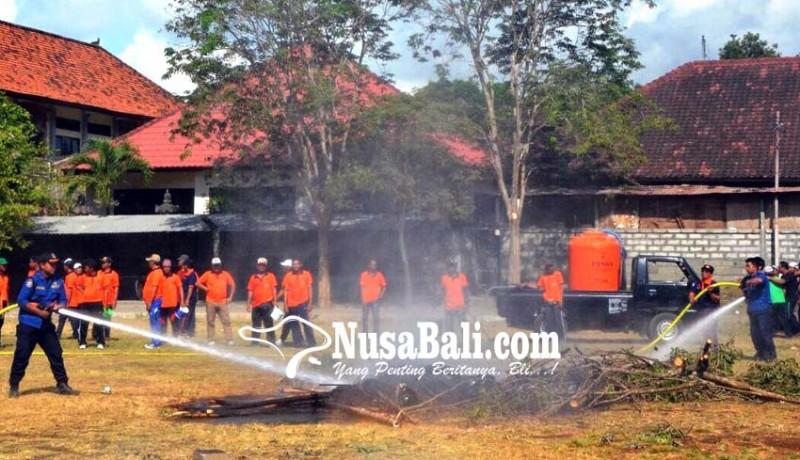 www.nusabali.com-puting-beliung-dan-kebakaran-terjang-desa-sedang