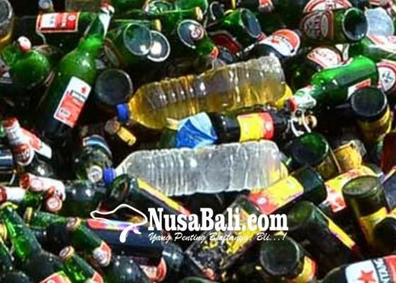 Nusabali.com - polres-jembrana-amankan-179-liter-arak